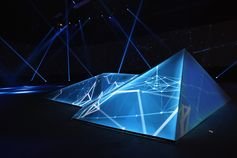 "Guests Find Secret Rooms, Encrypted Messages at Oakley Event.  The brand's ""Disruptive by Design"" launch was intended as a fully immersive event that celebrated its past, present, and future through interactive multimedia installations.  A prism in the middle of the event space represented the energy of creation."