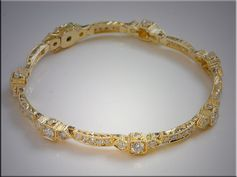 p505  18K Yellow Gold Custom Hand Engraved Ladys Bracelet with Ideal Cut Diamonds, design by Tim Frank