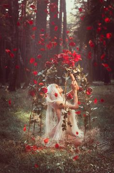 the virgin queen , hides in her gilded cage untouched by the stains and sinfulness of the outside world but always tempted by the soft velvet touch of the red rose buds that taunt her to come out and play...cool fairy fashion goddess art photo