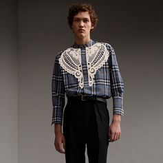 A neatly formed shirt with a grandad collar and double cuffs. Soft yarn-dyed check cotton acts as a canvas to the decorative Swiss-woven macramé lace appliqué.