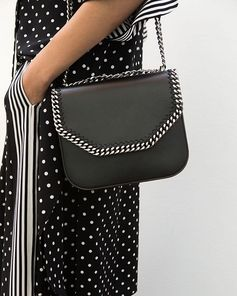 The signature #Falabella received a hard-edged style update.  Shop the new collection of #FalabellaBox styles at #StellaMcCartney.com.