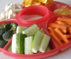 Veggie plates make the perfect healthy snack or accompaniment to any meal.    The great thing is you can provide plenty of variety, so everyone in your family can have some of their favorites.    You can even have a little fun and add things to your vegetable tray like cheeses, pickles, fruit and more. Here are a few ideas to make your next yummy veggie and more plate.