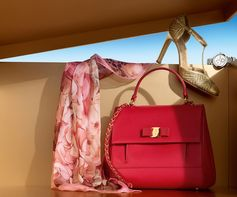"From a pink silk scarf to a red leather top handle bag to woven golden pumps and the ""Cuore"" watch in stainless steel, a box full of lovelies for the loveliest lady on your list.  holiday.ferragamo.com/"