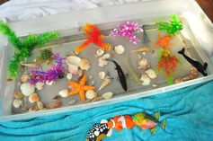 Play Theme: In the Sea. Ocean sensory  box toddler activity I CANNOT forget to reference this site when I decide to start doing themed teaching!! Great sensory box ideas + art project ideas, books, etc.