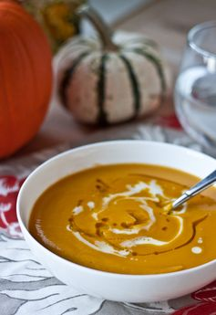 Acorn squash and sweet potato are roasted and blended together with sautéed onion, garam masala, ginger, and coconut milk to create a healthy and delicious fall soup.