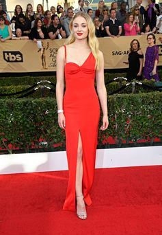 Sophie Turner wearing a custom made Louis Vuitton silk gown, silver sandals, high jewelry cuff and earrings to the 23rd annual Screen Actors Guild Award in Los Angeles.