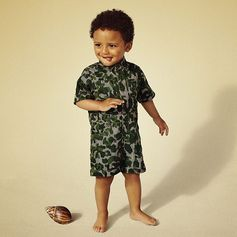 Babies go undercover in camo print all-in-ones for summer.