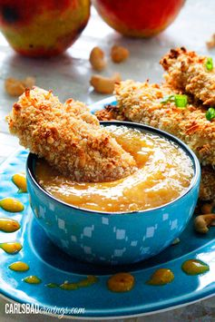 Crispy Cashew Coconut Crusted Chicken Tenders with Mango Honey Dip - Crunchy, spicy, and sweet. Sounds like a delicious dinner to us!