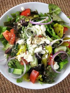 This beautiful and bright salad brings together the best of Mediterranean flavors: crisp romaine lettuce, juicy tomatoes, piquant peppers, cucumber, red onion, and tangy crumbled feta.