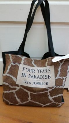 "True to the original colors and markings of Osa Johnson's book Four Years in Paradise This bag is 17x17"" with a solid black back and a black webbing strap. This bag has a Velcro closing but does not have any inside pockets. The price of this Tote Bag is $32.50"