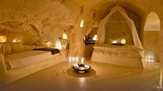 A luxurious hotel which boasts candlelit rooms that are carved into caves. The hotel is the result of a great restoration process that involved cave-dwellings, buildings, stairs, narrow streets and courtyards thus creating a new concept of hote