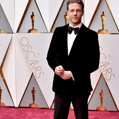 Luke Bracy, from the Academy Award-nominated film #HacksawRidge, walked the #Oscars red carpet in a #Ferragamo black velvet two-button evening jacket with black tuxedo trousers.