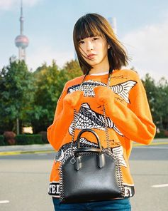 Nothing fishy here! @FilXiaobai takes us to the streets of Shanghai in new season intarsia with our latest #OneCityOneGirl story.  Watch the film and read the interview on #StellasWorld at #StellaMcCartney.com. #FalabellaBox