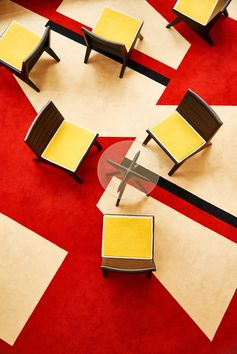 The retro lobby of a new boutique hotel. Love the geometric red and beige carpet and the midcentury-inspired chairs.