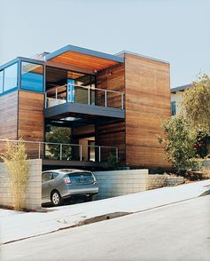 #modern   Love it, minus that earthy car!  Great use of modern elements and horizontal mahogany wood, great use of cable rail.