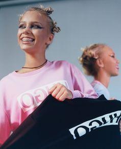 Social media stars Lisa and Lena wear the HUGO Reversed sweater