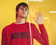Red alert: new-season color for the HUGO Reversed, worn by model Julian de Gainza