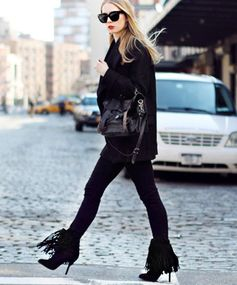 Made for Swinging Fashion blogger Carolina Engman plays with texture in this black-on-black look. The star element is her fierce fringe stiletto boots. Loving these? Try Aquazzura Fringe-Trim Sasha Booties.