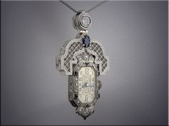 18K white gold antique style watch pendant with diamonds and sapphire.