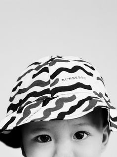 A playful printed hat from the new Burberry childrenswear collection.