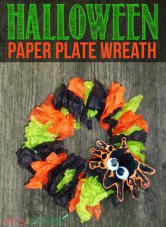 Halloween Paper Plate Wreath with an adorable hand print spider! #halloween #toddler #craft