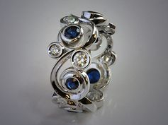 14K White Gold Diamond and Sapphire Scroll Band.