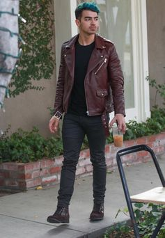 Joe Jonas hangs out in leather and blue.
