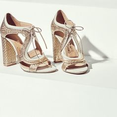 From the new Ferragamo Spring 2017 women's collection, the season's most radiant pair. Crafted in woven gold leather, trimmed in canvas and featuring cut-out design, these sandals will brilliantly accompany your every step.  ferragamo.com/