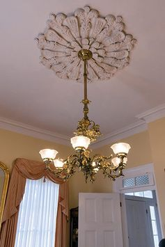 Ornate 19th century brass chandelier and ceiling medallion.