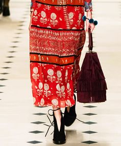 Tasteful Layers Burberry's Fall 2015 collection gave fringe a grownup facelift in the form of this plum colored handbag with elegant tasseled layers.