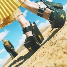 Step it up in disco-vibe star embellished platforms.  Shop new season footwear at #StellaMcCartney.com.