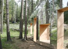Invisible Barn is a mirror-clad folly camouflaged among the trees of a California forest.