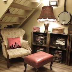 Tuck your nook under the stairs. | 19 Cosy And Covetable Reading Nooks