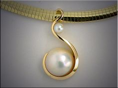 14K yellow gold slide with pearls by Gemstone Designs.