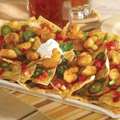 You and the kids will gobble down these Popcorn Shrimp Nachos at your Super Bowl party on Sunday! #easy #quick #appetizer