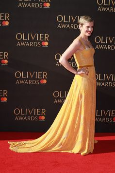 Dressed in Burberry, actress Denise Gough at the Olivier Awards wearing a yellow georgette and velvet gown