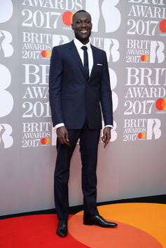 BRITs nominee for British Breakthrough Act Stormzy wears Burberry tailoring on the red carpet last night