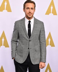Ryan Gosling wears a wool Ferragamo Prince of Wales jacket.