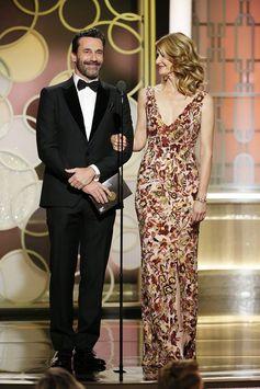 On stage at the Golden Globes, presenter Jon Hamm wore a black Ferragamo tuxedo with velvet peak lapels & patent lace-ups.