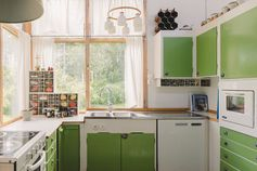 Love the use of green on the doors of these cabinets.