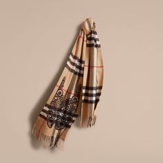 The Classic Cashmere Scarf in check with lace embroidery is made at a 200-year-old mill in the Scottish countryside. Using 30 different steps, the scarf is woven on traditional looms. The fabric is washed in local spring water and carefully brushed with teasels for a super-soft finish.