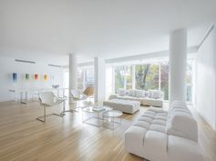 This all-white apartment in the Off Prospect Park building by Richard Meier in New York City is currently for sale.