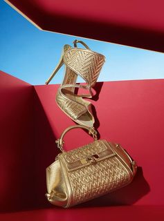 Woven leather with a golden patina makes for one dazzling duo. From the Ferragamo Holiday gift selection, the new season's sling-back sandal and mini Soft Sofia top-handle bag. holiday.ferragamo.com/