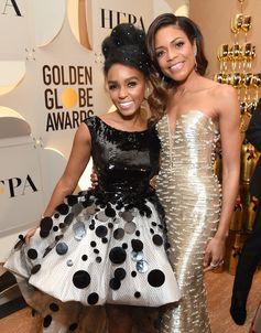 Presenter Janelle Monae alongside nominee Naomie Harris, both in custom Giorgio Armani Privé outfits, at the 74th Annual Golden Globe Awards. #ArmaniStars