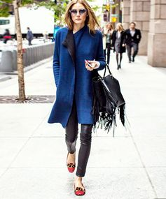 Trendy Trim Once Olivia Palermo rocks a trend, you know it's time to pay attention. The fringe embellishments on her posh leather bag bring a subtle touch of trendiness to an otherwise classic ensemble. Recreate her look with this Valentino fringe tote.