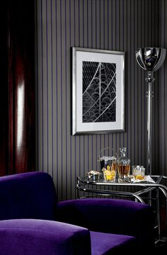 Settle into a deep classic club chair covered royal purple, with a well crafted cocktail courtesy of the Modern Metropolis bar trolley