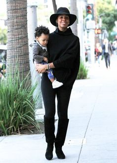 Kelly Rowland goes for a walk with son Titan.