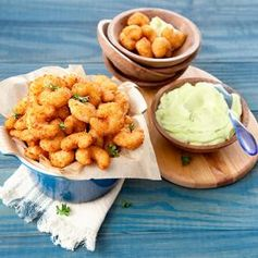 Looking for a super easy Super Bowl party appetizer? Look no more: Popcorn Shrimp With Spicy Avocado Dip. So delicious!