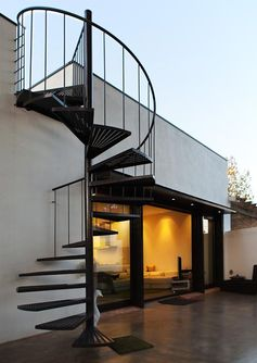 outdoor spiral staircase and wide-open walls - a favorite combination! PC House by XVA