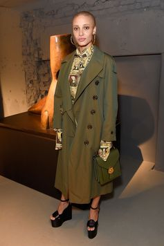 Adwoa Aboah wearing Burberry outerwear and a straight fit shirt tailored with a neat point collar and single-button cuffs from the Burberry February collection to attend the Burberry show at Makers House in London